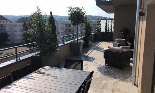 Création d'une terrasse végétalisée sur une terrasse d'immeuble